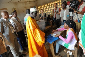 A voter participates in the first legislative election in Côte d'Ivoire with the presence of international observers.