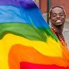 An activist waves a rainbow flag, an international symbol for the rights of gay, lesbian, bisexual and transgender people.