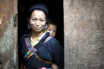 A H'mong woman and her baby in Sin Chai hill tribe village