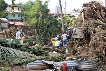 Residents of Mindanao, Philippines, survey damage caused by tropical storm Washi