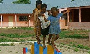 Children in Gantauda, Guinea-Bissau develop their motor skills on the balancing beam.