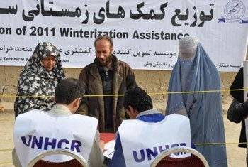 Vulnerable Afghan families line up to receive winter supplies in Dahsabz, a suburb of Kabul.