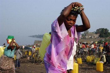 Women carry jerry cans of chlorinated water which is being used to contain cholera in eastern DRC.