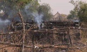 A burning tukul (hut) in Pibor, South Sudan