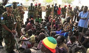 UNMISS Force Commander Moses Obi (left) talking to displaced people in Pibor, South Sudan