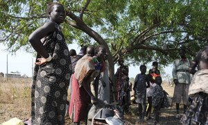 Internally displaced persons (IDPs) preparing a meal in South Sudan.