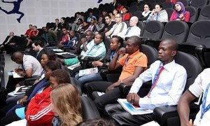 Programme participants attend the opening session in Doha.