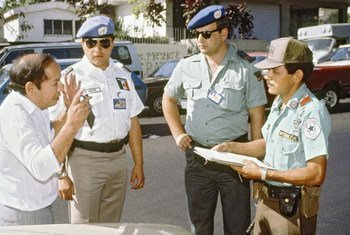 ONUSAL police observing a Salvadoran police officer (right) making a traffic stop, 1 February 1992.
