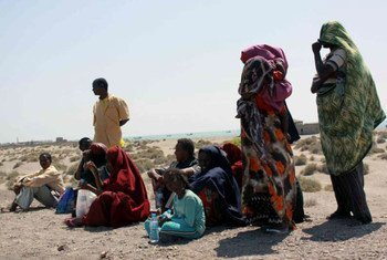 A group of Somalis wait on Yemen's Red Sea coast for transport to Aden.
