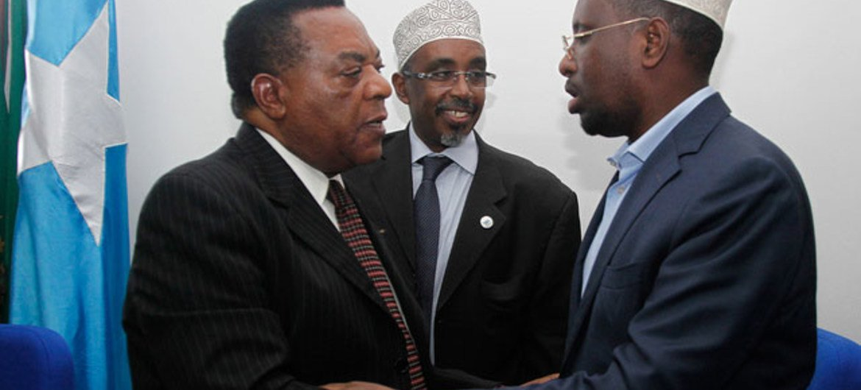 Special Representative Augustine Mahiga (left) greeting President Sheikh Sharif Sheikh Ahmed of Somalia in Mogadishu on 6 September 2011.