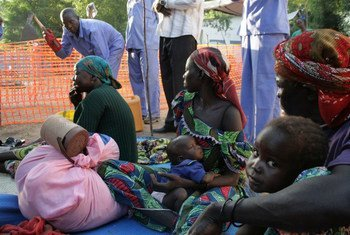 Cholera patients learn about sanitation from health workers.