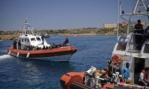 Italian coastguard vessels arrive at Lampedusa Island after rescuing people on the Mediterranean. (January 2012)