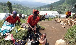 A Congolese woman washes clothes at a hillside camp for the internally displaced in North Kivu's Masisi District.