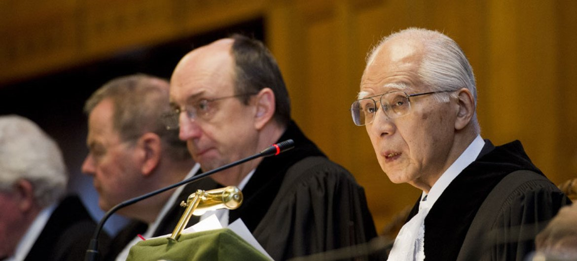 President of the International Court of Justice Hisashi Owada (right), reads out the Court's Judgment in the case between Germany and Italy.