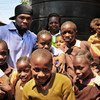 "Rapper Curtis ""50 Cent"" Jackson with school kids in a Nairobi slum."