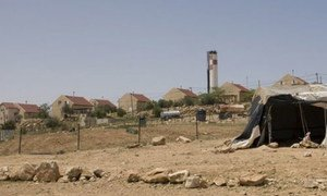 An Israeli settlement viewed from the Um-al-Kher bedouin community in the West Bank.
