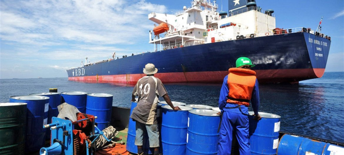 A crew member prepares to board a tanker that was hijacked by pirates in Benin on 24 July 2011.