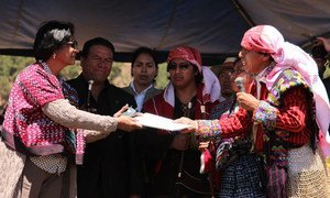 UN human rights chief Navi Pillay receiving petitions from indigenous authorities at a meeting in Guatemala.
