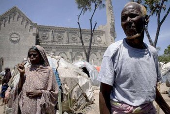 Somali civilians on the grounds of a ruined cathedral in Mogadishu in August 2011.