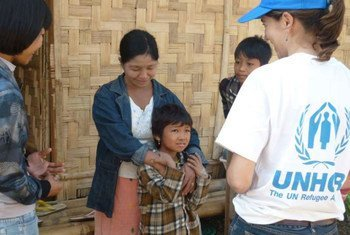 In a camp for internally displaced people in Kachin state, Myanmar, a family of five meets with a UNHCR staff.