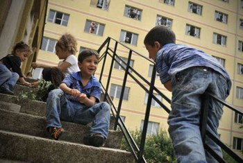 Young asylum-seekers play in front of a reception and integration centre in Bulgaria.