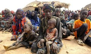 Malian refugee women wait with their children to receive relief items from UNHCR in Gaoudel, Ayorou district, northern Niger.