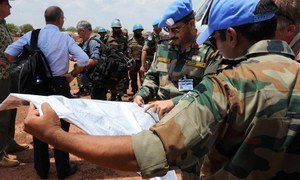 Personnel from the UN Mission in South Sudan (UNMISS) arrive in Mayom, Unity State, to evacuate wounded civilians.
