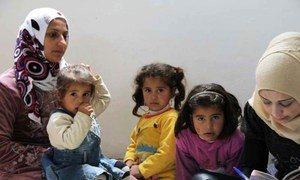 Members of a Syrian family register as refugees in northern Lebanon.