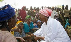 WFP Executive Director Ertharin Cousin (right) greeting local women on a visit to Niamey, Niger.