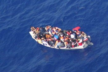 An aerial photo from the past shows an overcrowded boat off the coast of Malta.