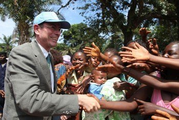 Assistant Secretary-General for Human Rights Ivan Šimonovic greeting residents of Kamako in the Democratic Republic of the Congo.