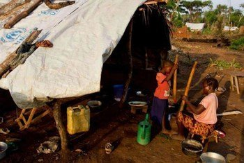 A woman and her son at a site near Dungu in the DRC after they fled Lord's Resistance Army (LRA) attacks.