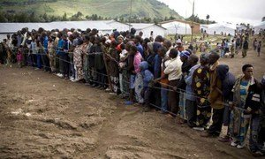Congolese refugees gather for a meeting in Nkamira transit centre, Rwanda, with UNHCR staff.