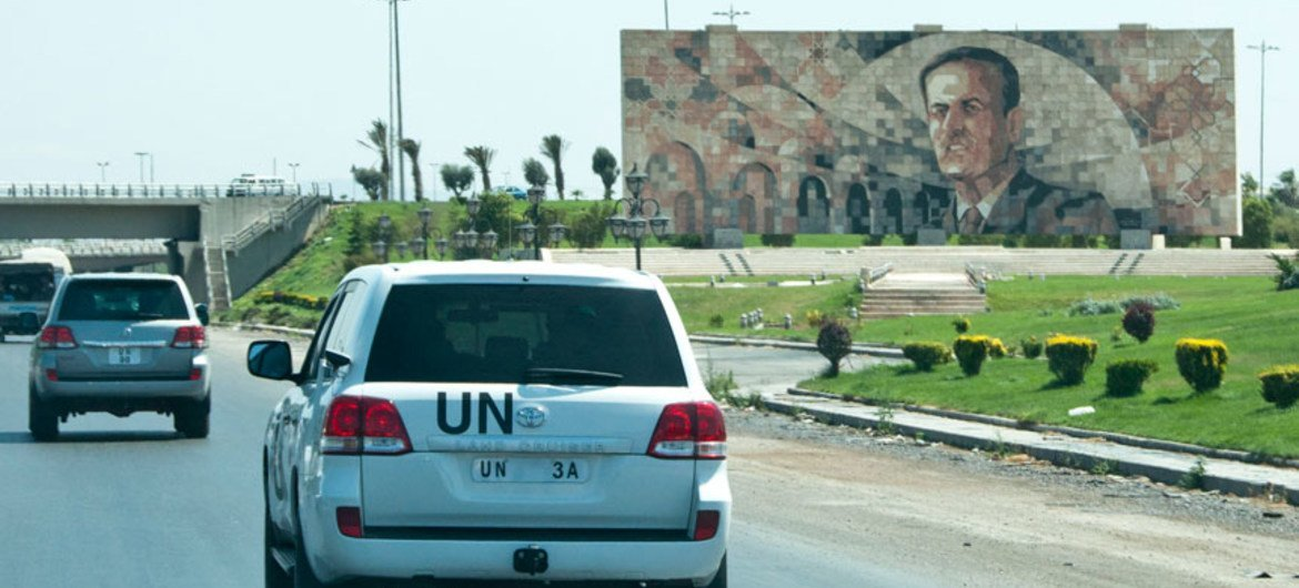 A convoy of UN observers travels in Syria.