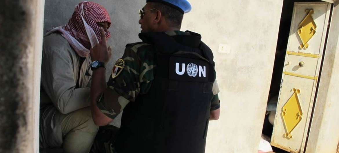 An observer with the UN Supervision in Syria interviews a local man while conducting a fact-finding mission in the village of Mazraat al-Qubeir.