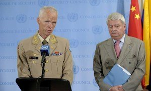 Head of the UN Supervision Mission in Syria and Chief Military Observer Major-General Robert Mood (left) and peacekeeping chief Hervé Ladsous brief press.