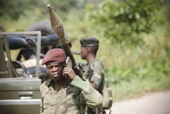 DRC army soldiers stand guard during a military operation to strike M23 positions close to Rutshuru in eastern North Kivu province.