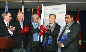 Secretary-General Ban Ki-moon (second from right), holding the Vancouver 2010 Olympic Torch.