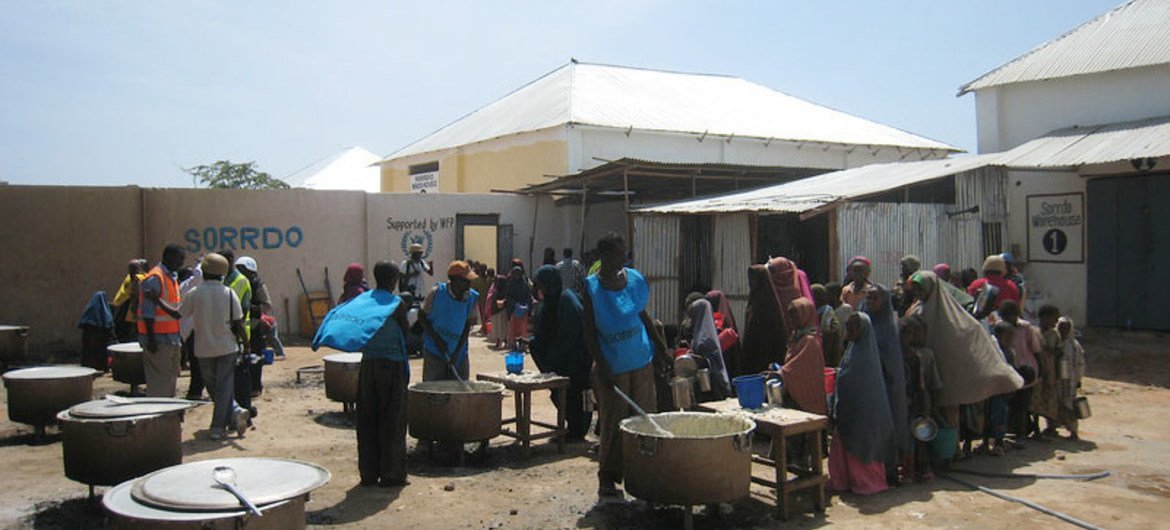 Aid workers prepare food for Somalis at a World Food Programme-supported feeding centre in the capital, Mogadishu.
