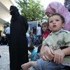 Syrian refugees at a UNHCR registration centre in the village of Jeb Janeen in Lebanon's Bekaa Valley.