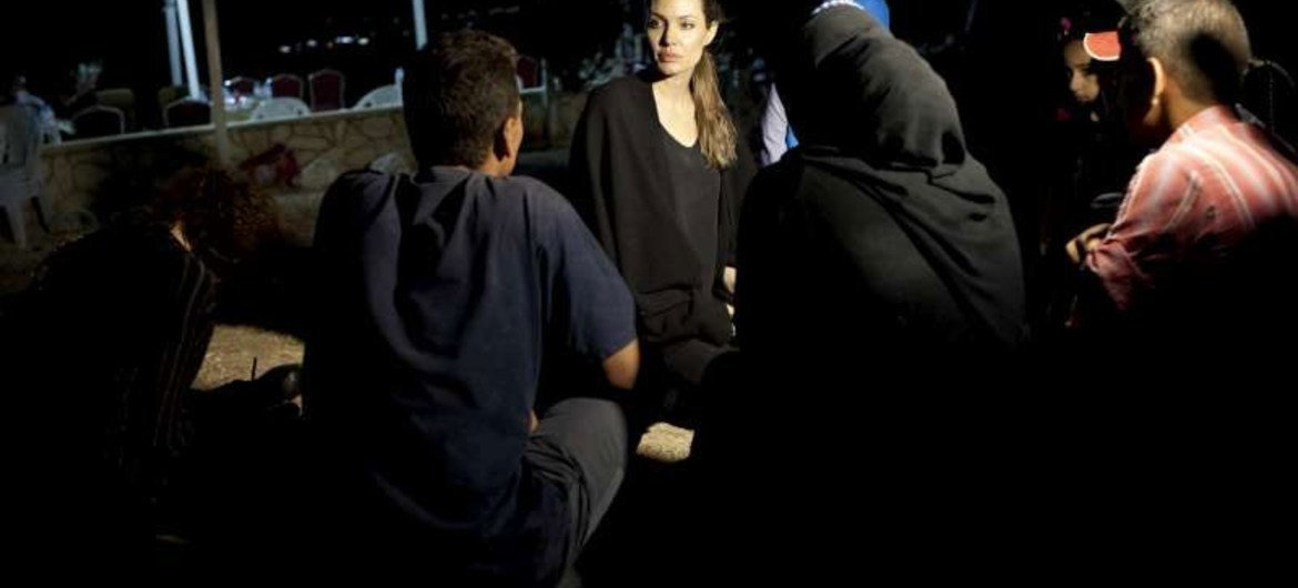 UNHCR Special Envoy Angelina Jolie meets with refugees on the Jordanian border minutes after they crossed from Syria.
