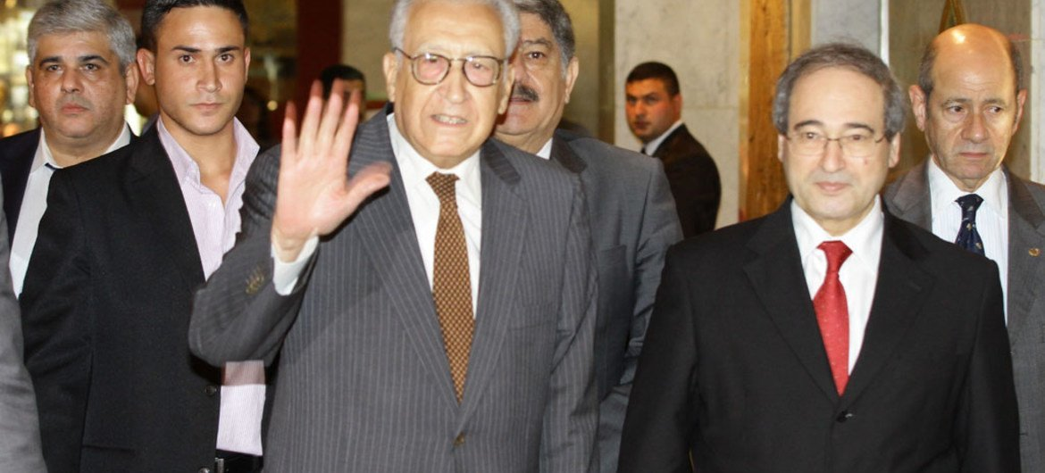 Joint Special Representative of the UN and the League of Arab States on the Syrian crisis, Lakhdar Brahimi, waves on arrival in Damascus.