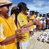 Children attending a soccer demonstration in a community helped by FAO and the Asian Football Confederation (AFC).