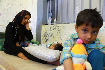 A mother and her children at a detention centre in Greece.
