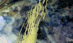 A NASA satellite image shows a vast alluvial fan blossoming across the landscape between the Kunlun and Altun mountain ranges that form the southern border of the Taklamakan Desert in China.