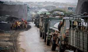 Kenyan troops serving with AMISOM make their way through the Somali port city of Kismayo following the ouster of Al Shabaab militants.