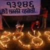 Candles at a memorial event form the number 13,246, the official count of Nepalis killed as of May 2006.