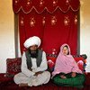 Soon-to-be-wed Faiz Mohammed, 40, and Ghulam Haider, 11, at her home in a rural village in  Afghanistan. © Stephanie Sinclair/VII/Tooyoungtowed.org