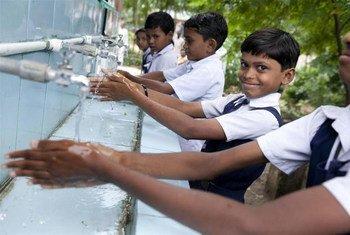 Children wash hands at their school in Bhatari, India.