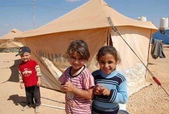 Syrian children outside their UNHCR tent at Jordan's Za'atri refugee camp.